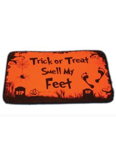 "This 15"" By 23"" Mat That Is A Decorated With Orange And Black Text Saying ""Trick Or Treat Smell My Feet"". Is Sure To Complete Your Holiday Hunt."